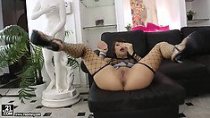 Brunette cutie Kirsten in her fishnet outfit blows cock and toys pussy