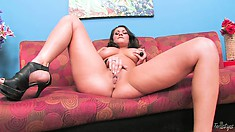 Sexy Latina with stunning curves strips and plays with her big wet pussy