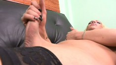 Horny blonde shemale in fishnet stockings plays with her big shaft