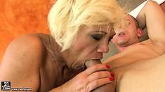 Naughty blonde hoochie mama sucks on a massive young schlong
