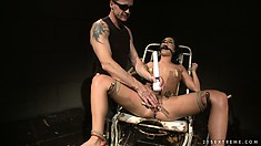 Sexy brunette babe bound in stirrups gets teased by her master