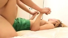 Naughty Japanese babe relinquishes her pussy to a horny guy on the bed
