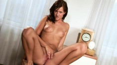 Striking brunette with perky boobs fingers and toys her slit to orgasm