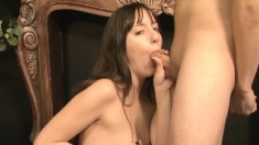 Charming brunette touches her shaved honey hole and bites a thick cock