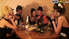 Naughty babes and horny guys dressed in retro costumes playing cards and drinking