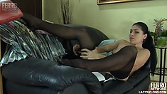 Muriel is getting dressed putting on her stockings and lingerie showing skin