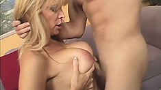 MILF Nicole Moore uses her big natural tits to snag a big cock