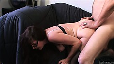 Nasty dude hungry for pussy gives this mature mum a good ramming on the sofa