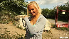 Skinny blonde hussy shows her great titties while going for a hike