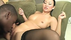 Sexy Asian chick in stockings has a black guy hammering her tight cunt