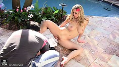 Blonde with massive natural tits rubs her perfect body by the pool