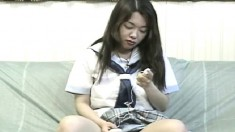 Barely legal Japanese coed in a sailor outfit teases with her undies
