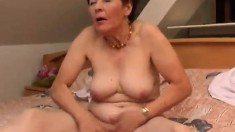 Chubby mature Susanna uses her glass dildo to fuck her old cunt