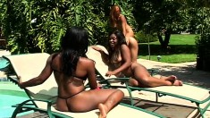 Sultry ebony lesbians having fun with their favorite toys by the pool