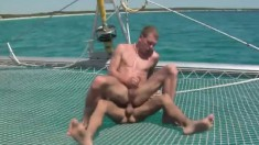 With The Sun Kissing Their Bodies, Two Horny Boys Have Sex On A Boat