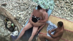Outdoor hot threesome on a beach