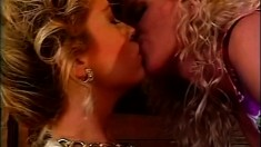 Two hot blonde lesbian babes kiss and lick each other