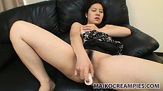 Marvelous Asian babe with perky tits drills her pink twat with her fingers and a dildo