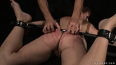 Slave gets a leg-spreader put on her and has her ass roughed up