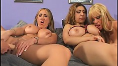 Four busty babes fulfill each other's lesbian desires with the help of sex toys