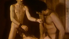 Vintage porn of tied up man getting a foot and two fists in his ass