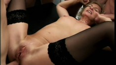 German lady in black stockings Connie Carey gets fucked by five studs