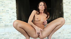 Delightful brunette with small tits and a tiny cunt that brings herself to perfect pleasure