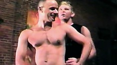 Two sexy studs are joined by a horny guy for an exciting gay threesome